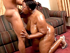 Huge black babe Tina Taboo gags on a plump cock and receives and hard pounding in her wet pussy black fat xxx